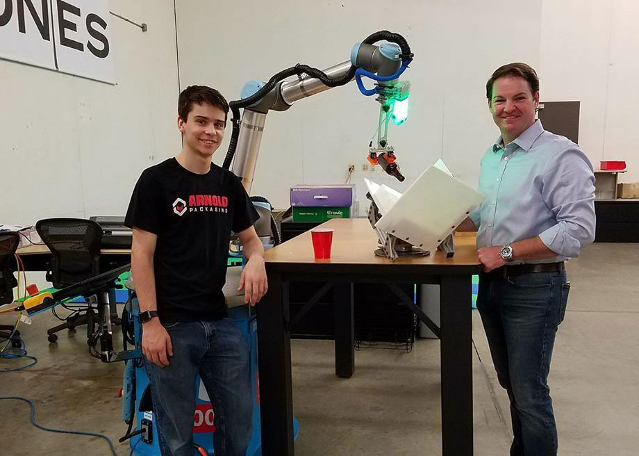 Mick Arnold and Steven Appel with Robot